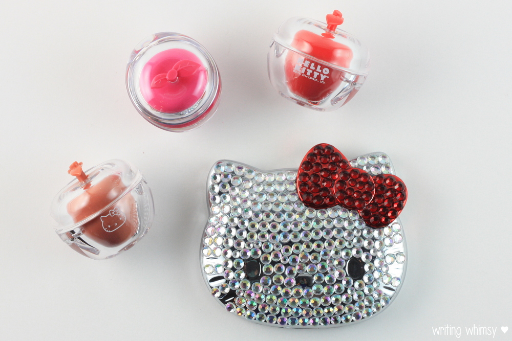 Hello Kitty Holiday Gift Guide Ruby Compact Mirror and An Apple A Day Trio Lip Balm Set 6
